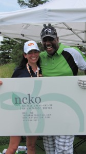 Natalie Cheng-Kai-On and Joe Carter at the Golf Tournament